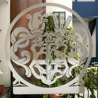 Emblem of the family Inzaghi at the entrance of Boutiquehotel Dom the former Palais Inzaghi